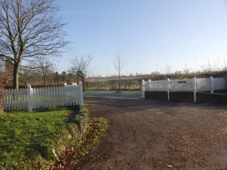 Turn left by the white fencing into Nomansland Farm